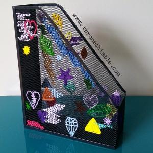 mesh magazine holder after pin